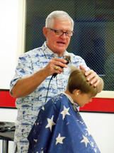 a barber giving a haircut
