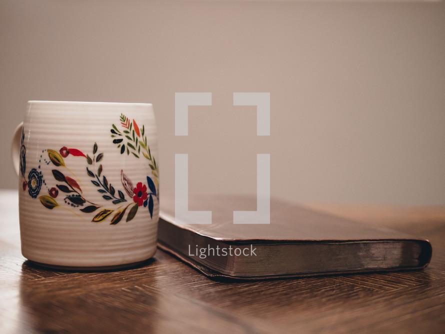 coffee mug and Bible