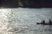 paddling canoes in water