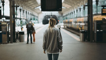 a woman at a train station