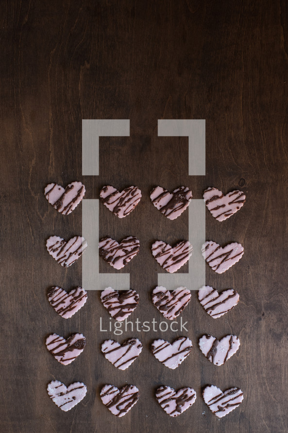 heart shaped cookies on a wood background