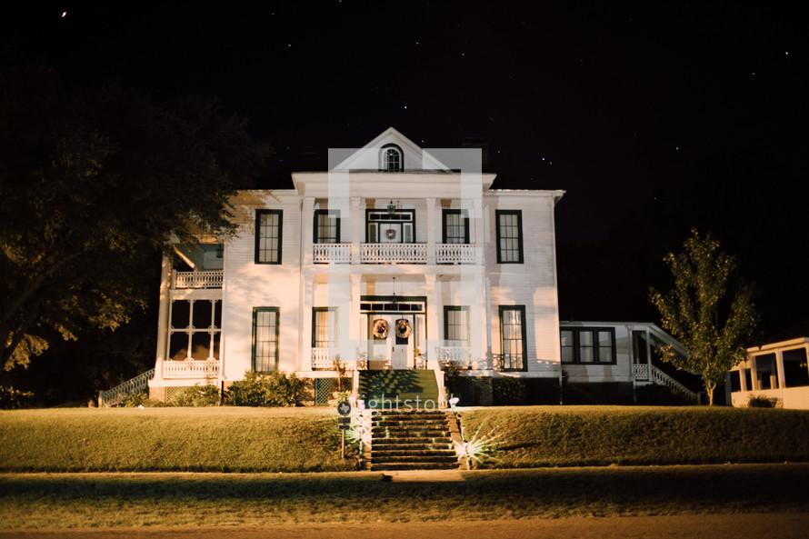 old house illuminated at night