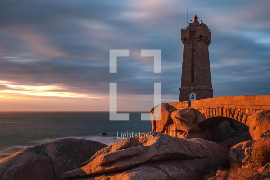 lighthouse on a rocky beach