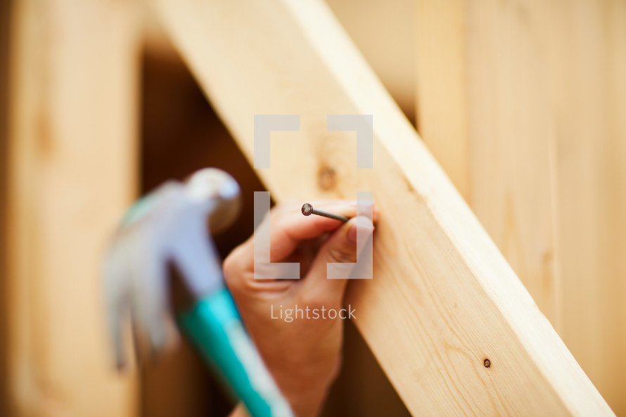 a volunteer building a house