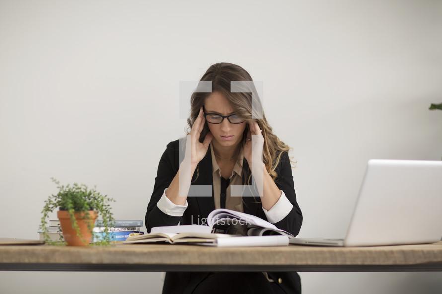 a businesswoman with a headache