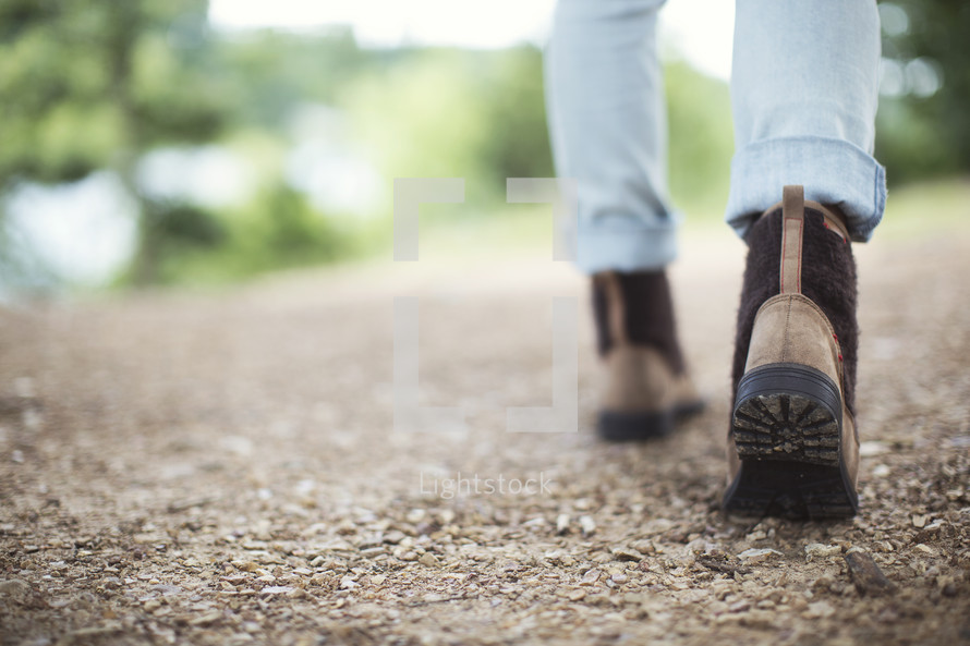 Close up of a girl walking on a nature trail.