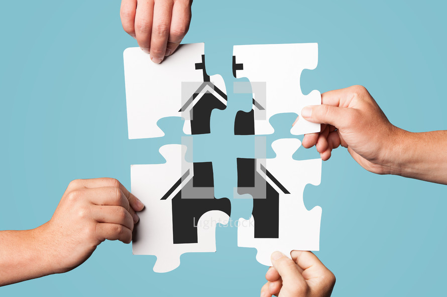 Four pieces of a puzzle held together to form a Church.