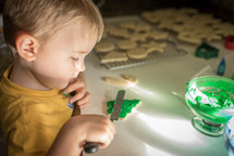 Child decorating Christmas cookies