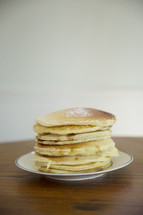 powdered sugar on a stack of pancakes