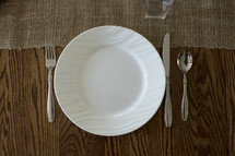 A place setting on a wooden table.