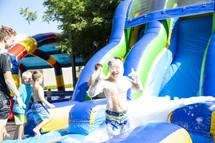 kids on a blowup slide