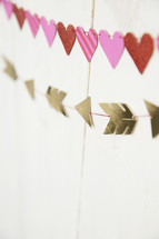hearts and arrows banner on a white wall