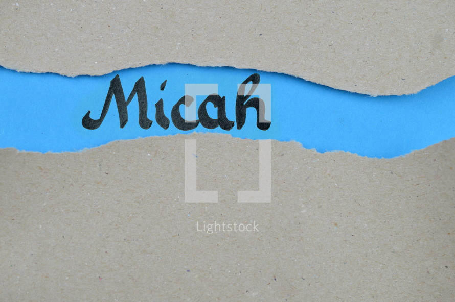 Micah - torn open kraft paper over blue paper with the name of the prophetic book Micah