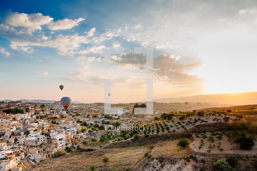 Hot air balloon festival over a town