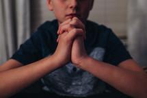 a boy praying