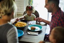 a family praying before dinner