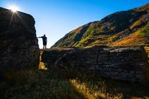 Runner standing on rocks, Southeast Alaska.