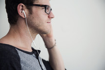 A man listening with ear phones.
