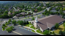 aerial view over a church parking lot