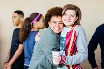 teen girls hugging