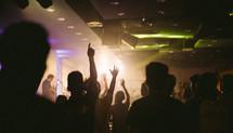 Crowd raising hands in worship