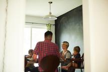 family eating dinner around a dinner table
