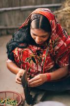 A woman chopping vegetables in Bangladesh