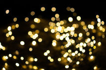 Bokeh from golden Christmas lights in the background. Perfect for your advent designs.