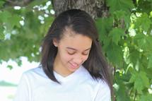 head shot of a teen girl looking down