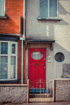 red door to a row house