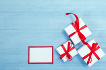 red and whet gift boxes on a blue background
