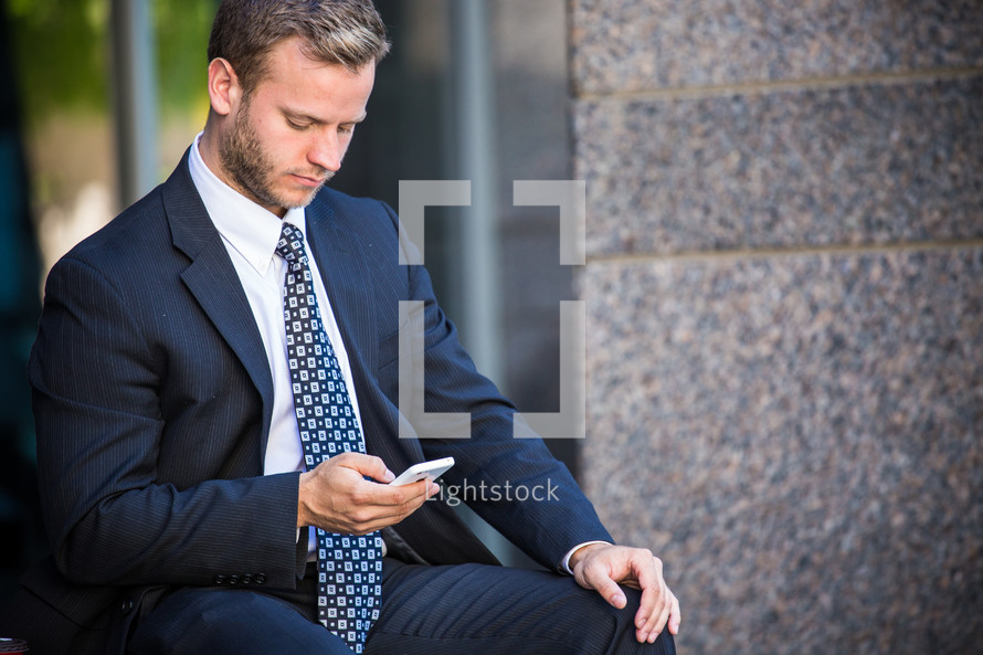 businessman checking his cellphone