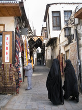 Muslim women walking on a street in Damascus