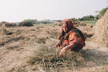 woman gathering straw