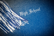 tassel on a high school diploma