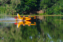 a boat landing on a lake