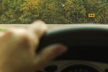 driving towards an arrow street sign