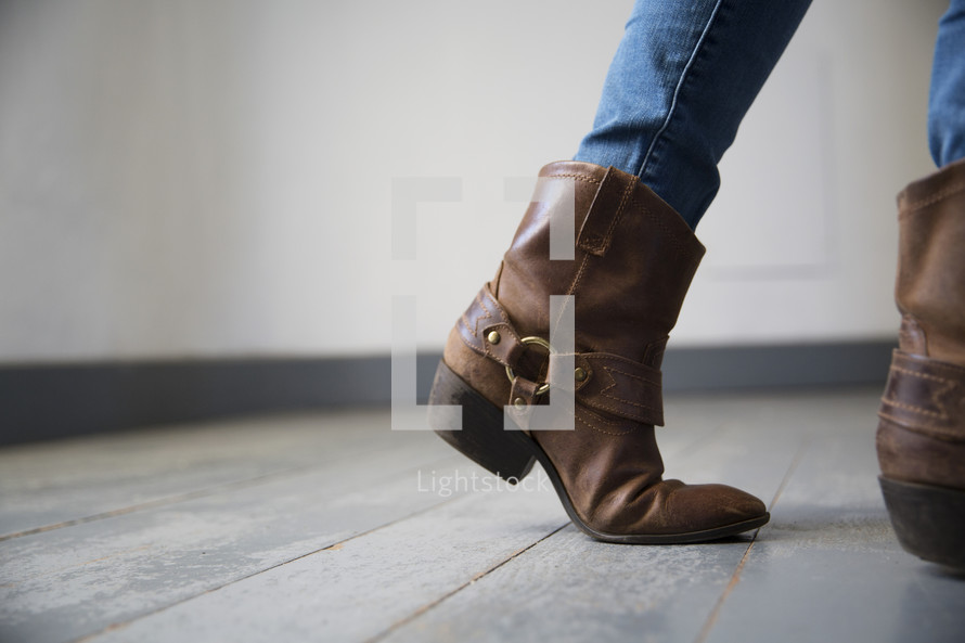 boots standing on wood floor boards