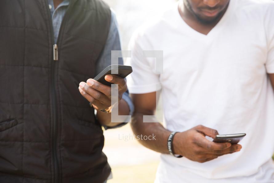 men checking their cellphones