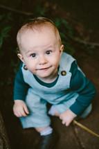 toddler boy looking up at the camera
