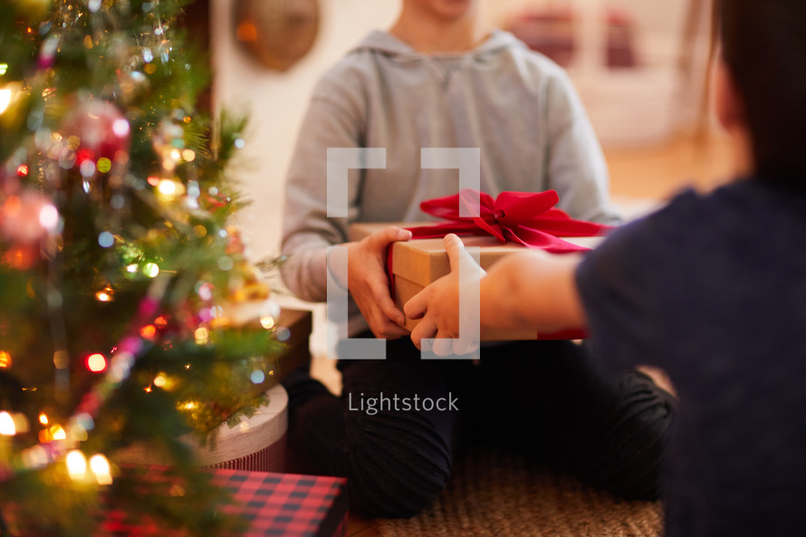 brothers giving Christmas gifts