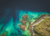 aerial view over turquoise waters