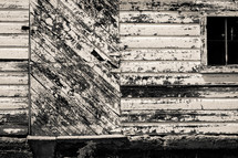 Weathered wood on a house.