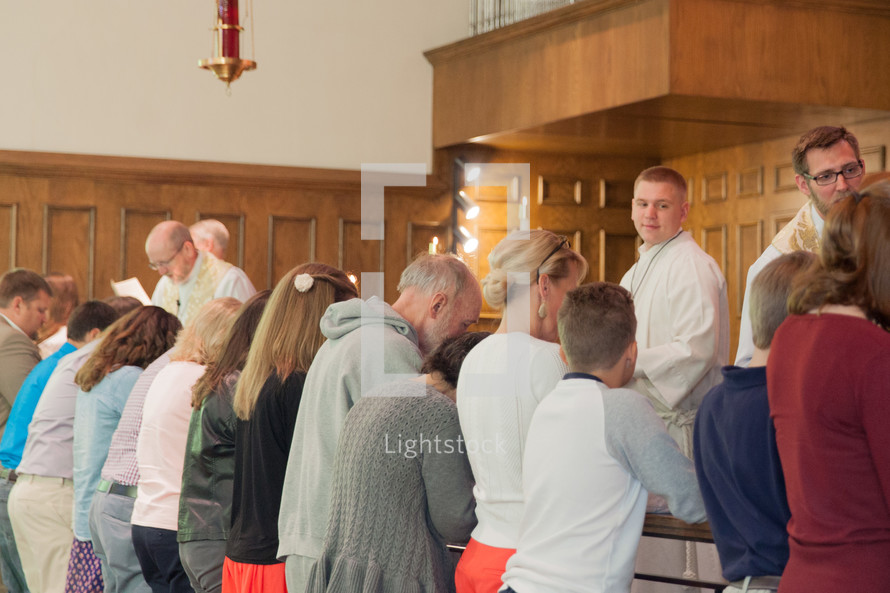 people receiving communion