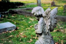 Visiting Cherub Angel praying and kneeling at the grave stone of a departed loved one. In Memory of dearly loved family members who have gone on before us, until we meet again.