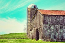 old weathered barn and silo