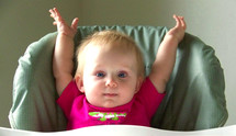 baby with her hands in the air