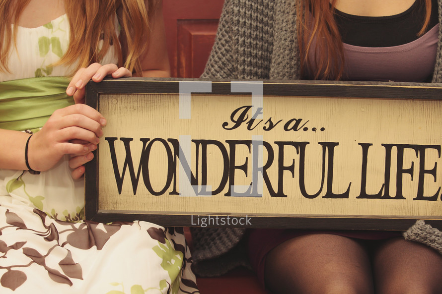 """""""it's a wonderful life"""" quote on sign"""