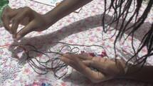making bracelets in Haiti