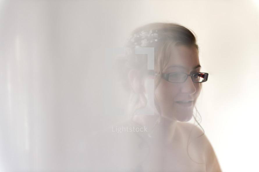 white light on a bride in glasses